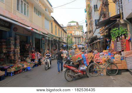 HANOI VIETNAM - NOVEMBER 23, 2016: Unidentified people visit Old Quarter district.