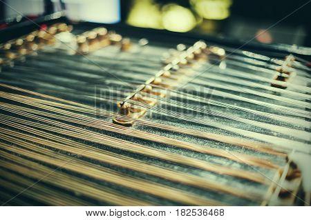 Wooden czech dulcimer traditional musical instrument. Detail on strings