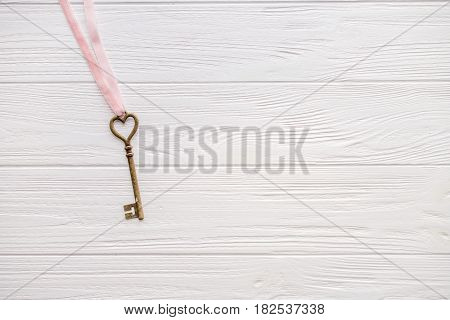 Key on a white background, top view. Minimal style. Flat lay. Trendy minimal flat lay concept