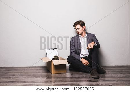 Fired Frustrated Sad Man In Suit Sitting On Floor In Office.