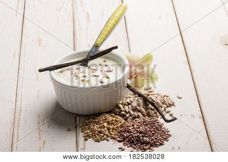 vanilla yogurt with linen and sunflower seeds
