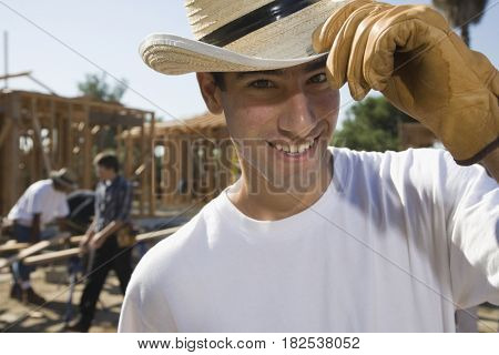 Hispanic construction worker wearing hat