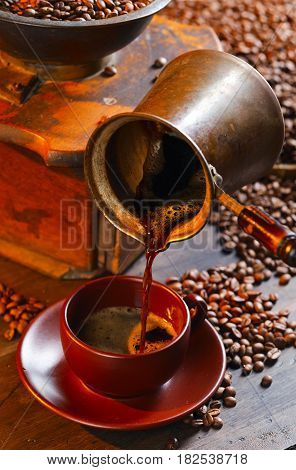 Fresh Hot Coffee Is Poured Into The Cup .