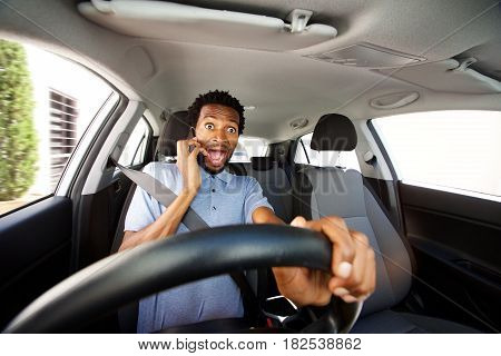Distracted Man Driving In Car Talking On Smart Phone