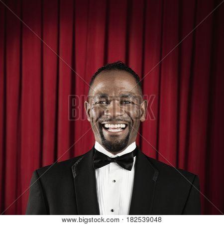 African American man in tuxedo posing