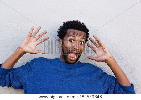 Close Up African American With Hands Raised In Shock