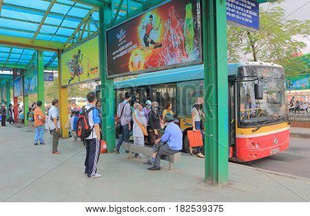HANOI VIETNAM - NOVEMBER 23, 2016: Unidentified people wait for a bus at Long Bien bus terminal.
