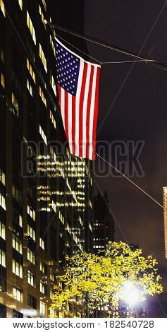 American Flag Waving From Manhattan's (new York) Buildings At Night