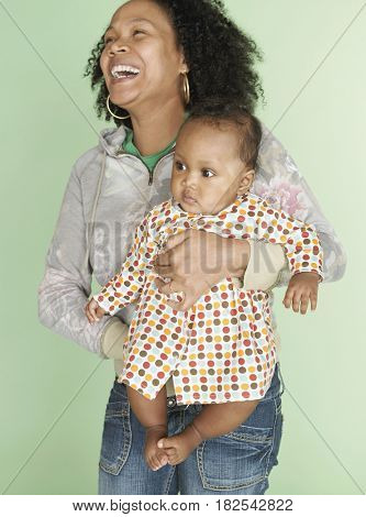 Mixed race mother holding baby daughter