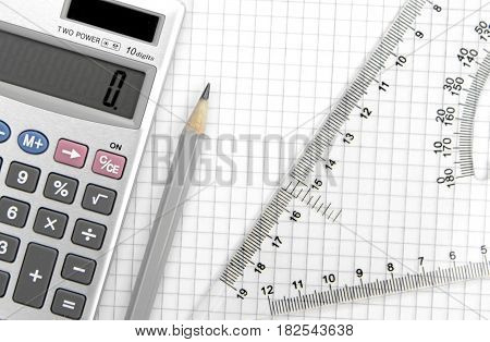 Calculator, lead pencil and ruler on squared paper