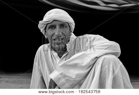 ISRAEL. NEGEV DESERT - SEPTEMBER 12 2014: A traditional dressed Bedouin at Negev desert. Black and White. Israel