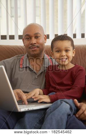 Antiguan father using laptop with son