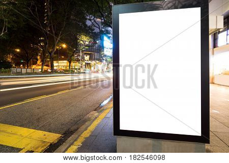 night scene of empty light box on street in modern city