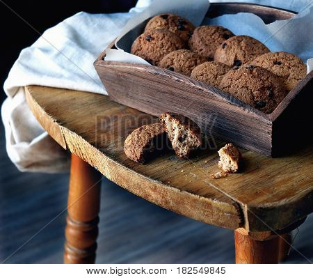 oatmeal cookies with chocolate chips in a wooden box.