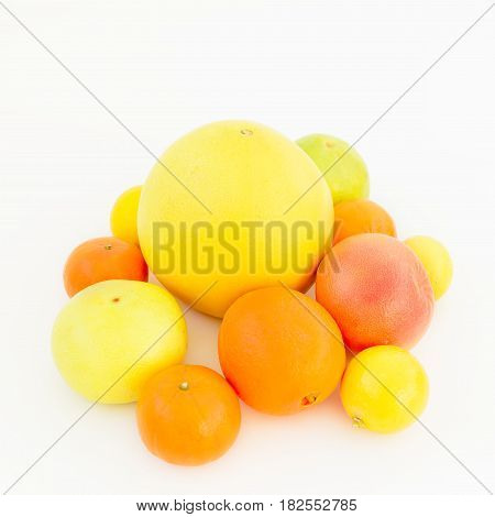Fresh lemon, orange, mandarin, grapefruit, sweetie and pomelo fruit on white background. Flat lay, top view.