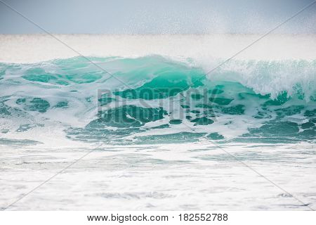 Ideal big breaking ocean barrel wave on the Oahu Hawaii