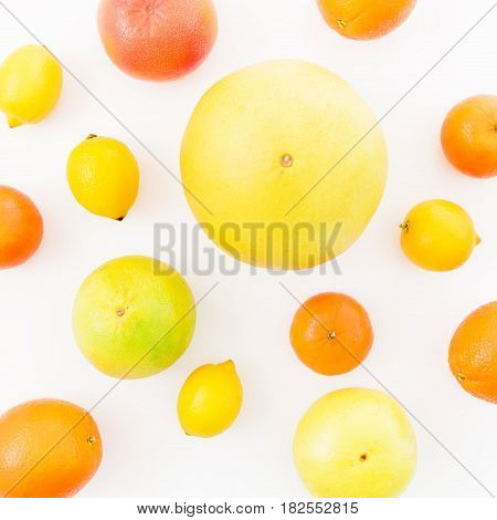 Lemon, orange, mandarin, grapefruit, sweetie and pomelo fruit on white background. Flat lay, top view. Summer fruits