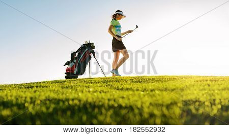 Professional Female Golfer On Golf Course