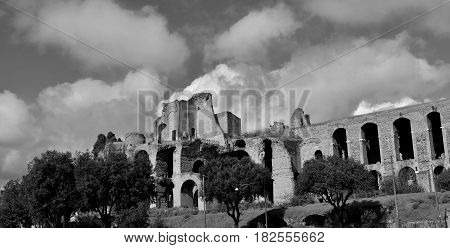 Imperial Palace ancient ruins at the top of Palatine Hill in Rome panoramic view with beautiful clouds (Black and white)