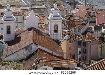 Lisbon, Portugal, April 5, 2017 : Roofs And Sao Miguel Church In Alfama. Alfama Is The Oldest Distri