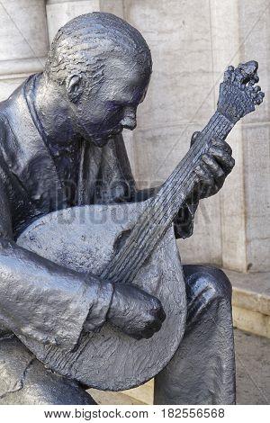 Lisbon, Portugal, April 8, 2017 : Sculpture Of Fado Musician And Dancer In Rossio Station.  In Popul