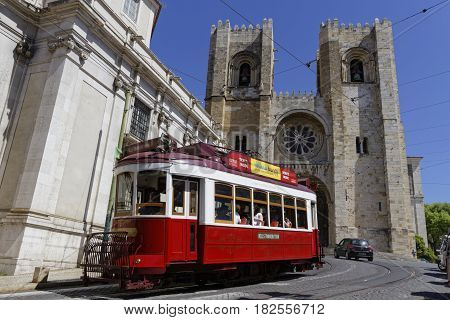 Lisbon, Portugal, April 5, 2017 : Touristic Tramway In Front Of Se Cathedral. The Tramway Network Se
