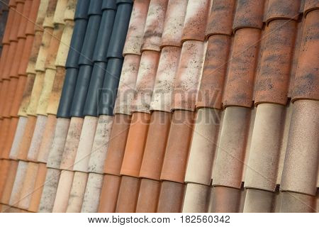 Samples of roof tiles on the roof in the exhibition hall. Industry