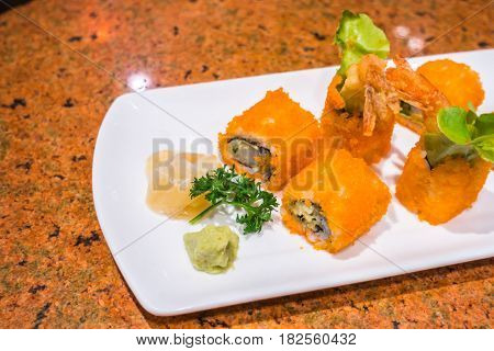 Japanese  Sushi rolls with fresh raw salmon on white plate