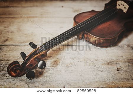 violin in front of wooden background vintage filtered and horizontal