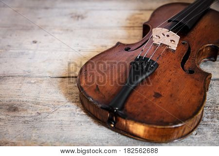one violin on a wooden table with copy space