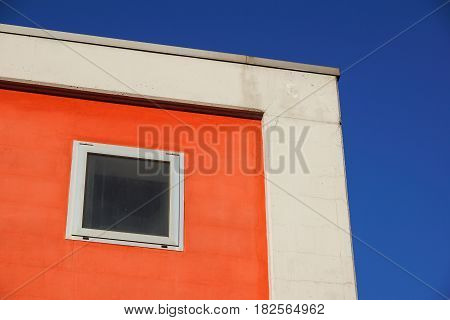 Architecture. Red facade of a building with windows. Colorful facade .