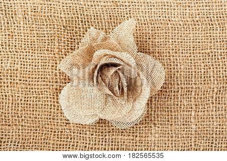 rose made of sackcloth material on sackcloth texture