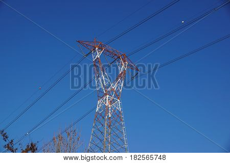 high voltage post.High-voltage tower at sky background