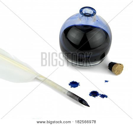 Quill pen with ink blots and glass ink bottle