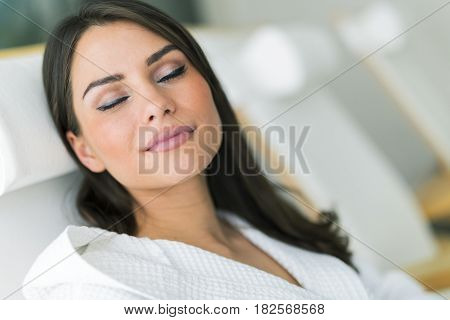 Portrait of a beautiful young healthy woman relaxing in a robe