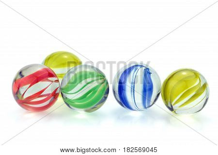 Colorful glass marbles, on white background .