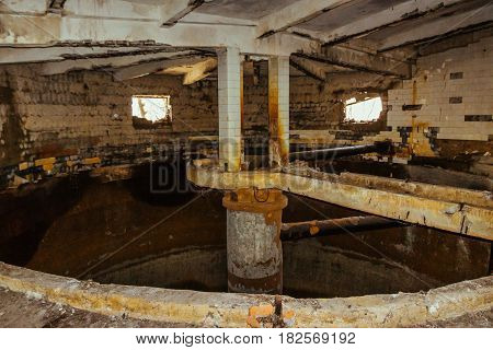 Room with a circular capacity and destroyed walls, abandoned factory, ruined building