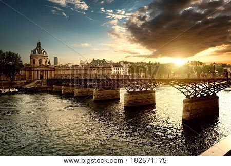 View on Pont des Arts and Institut de France in Paris at sunset