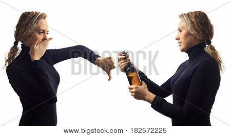 Self talk concept. Portrait of young woman talking to herself in mirror offering beer in bottle disapproving in reply. Double portrait