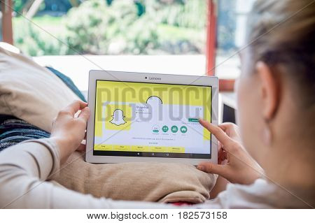 Wroclaw, Poland- April 10Th, 2017:  Woman Is Installing Snapchat Application On Lenovo Tablet. Snapc