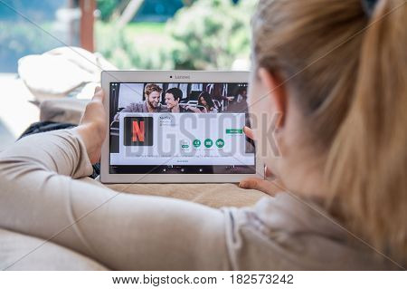 Wroclaw, Poland- April 10Th, 2017:  Woman Is Installing Netflix Application On Lenovo Tablet. Netfli