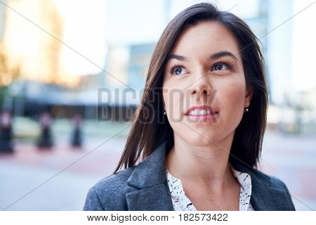 Portrait of a confident, happy female business entrepreneur wearing fashionable suit on her way to the next consultant meeting