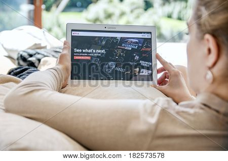 Wroclaw, Poland- April 10Th, 2017:  Woman Launches Netflix Application On Lenovo Tablet. Netflix Is
