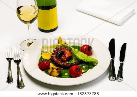 Seafood Dish With Fried Octopus Tentacles And Vegetables