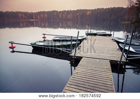 Floating Pier With Moored Row Boats, Still Lake