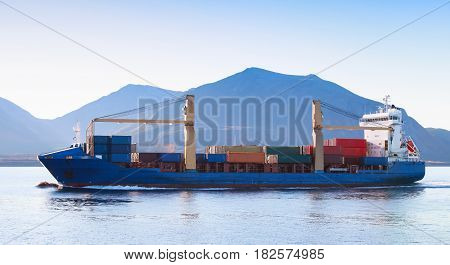 Container Ship Goes On Norwegian Sea, Side View