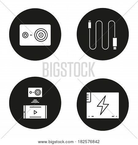 Action camera icons set. Mini USB cable, battery, action camera to smartphone wireless connection. Vector white silhouettes illustrations in black circles