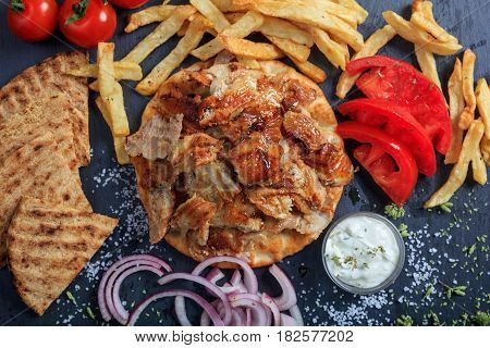 Greek Gyros Dish On A Black Dish - Top View
