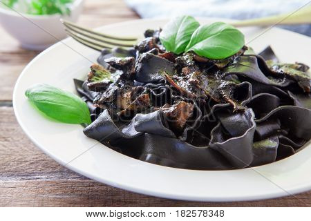 italian pasta with squid and black ink sauce