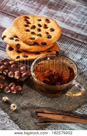 cookie chocolate and tea on a wooden table